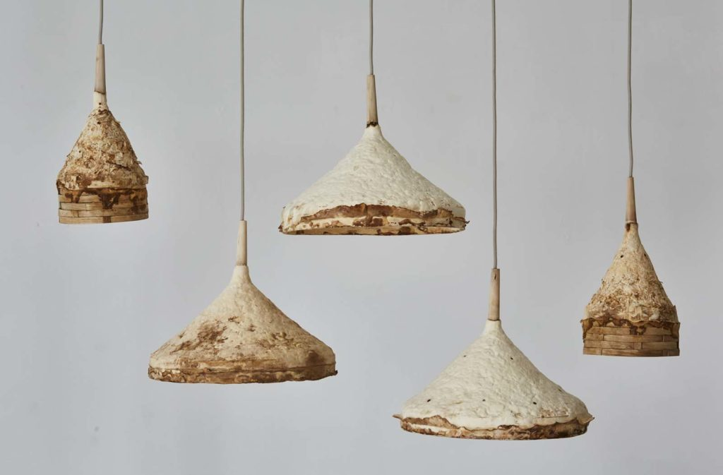 a photo of a series of suspended lampshades