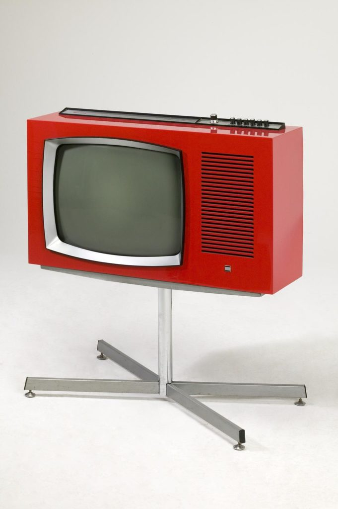 bright red television set on chrome stand