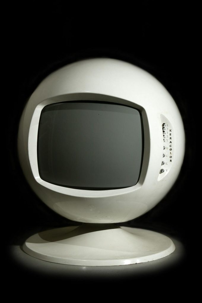 white spherical tv set with round white plastic base
