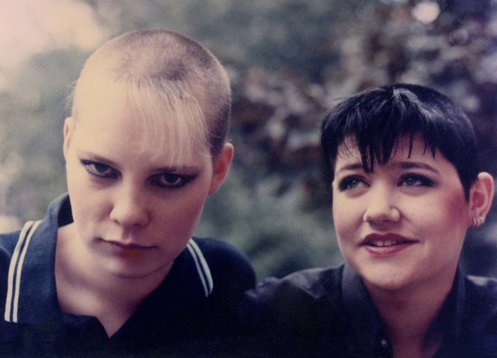 a photo of two skinhead girls