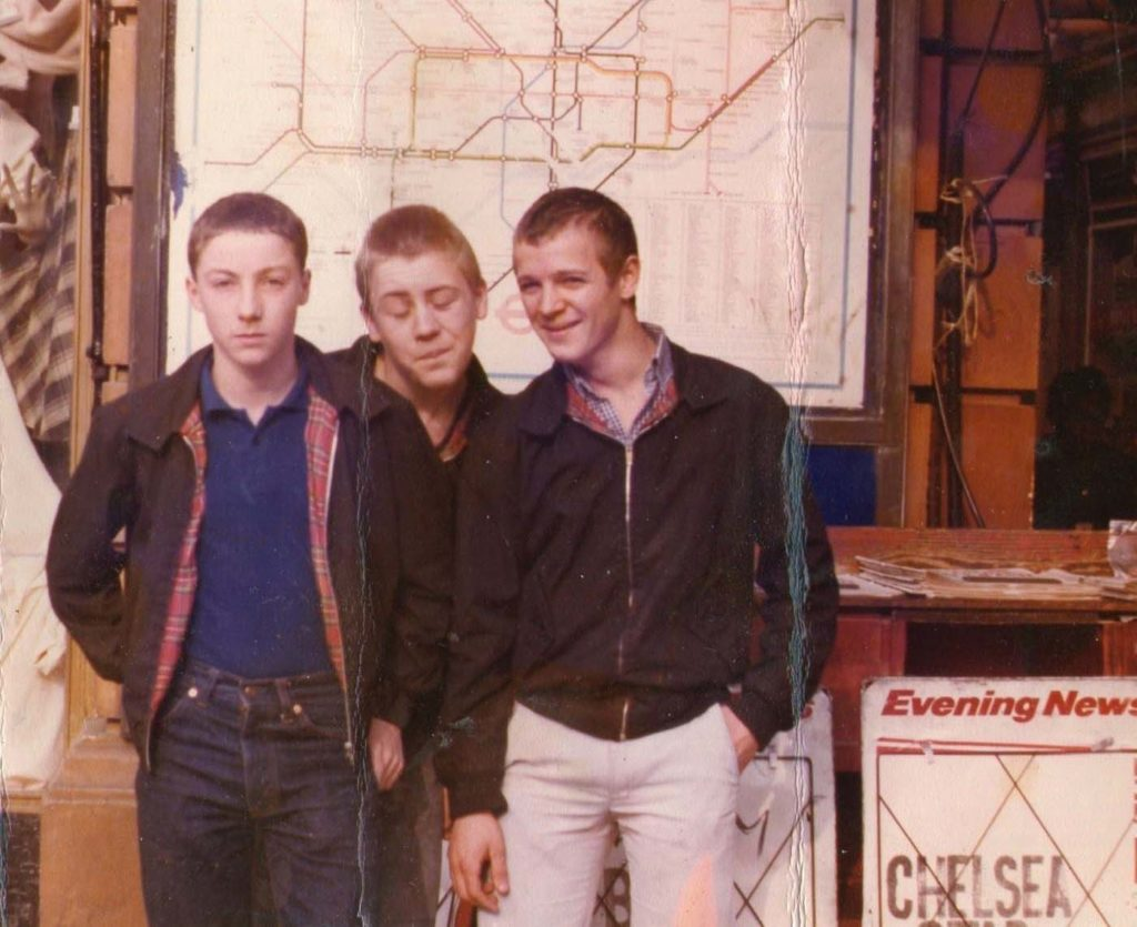 photo of three skinheads wearing harringtons and jeans outside a tube station