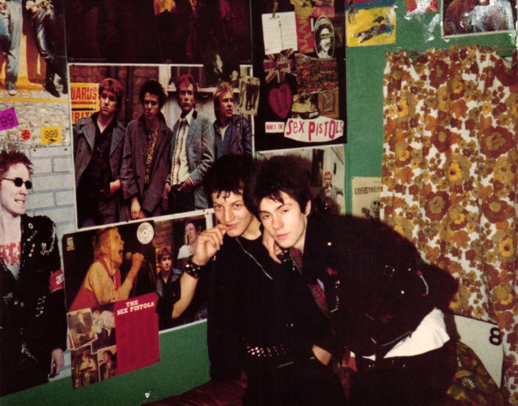 photo of two young punk kids in a bedroom festooned with Sex Pistols posters