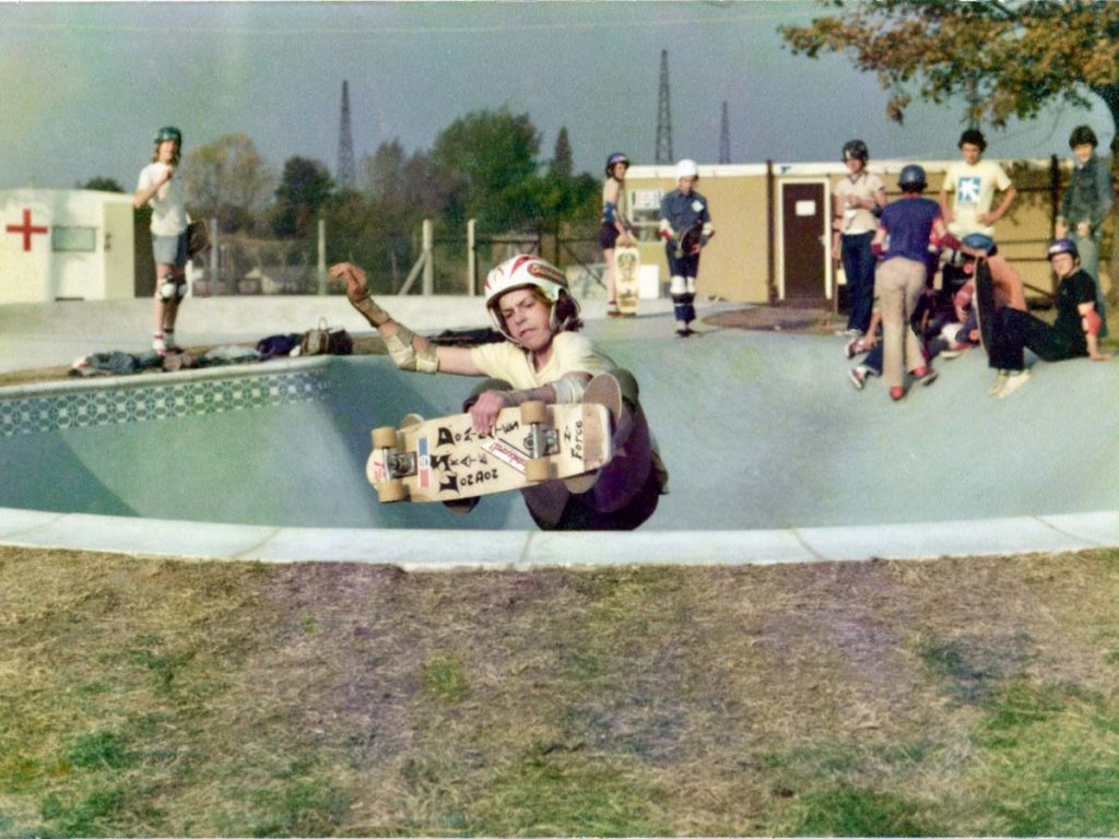 snapshot of a young skater riding a skate bowl