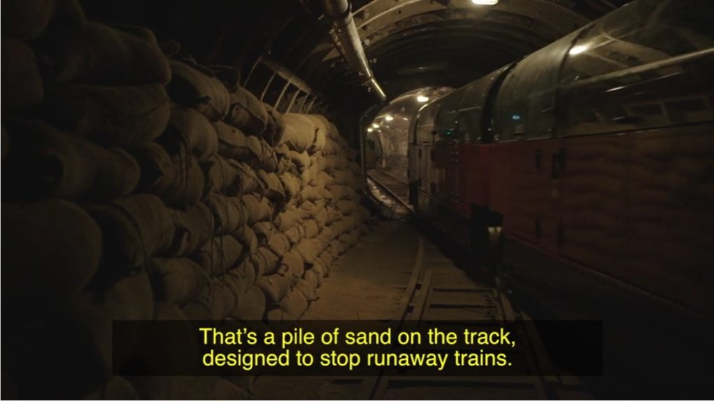 still frrom mail rail videos showing sandbags lining the wall of the train tunnel, with train passing