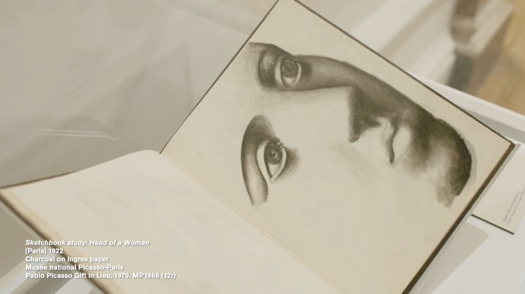 still from video of picasso exhivition at the Royal Academy showing sketch of face in sketchbook