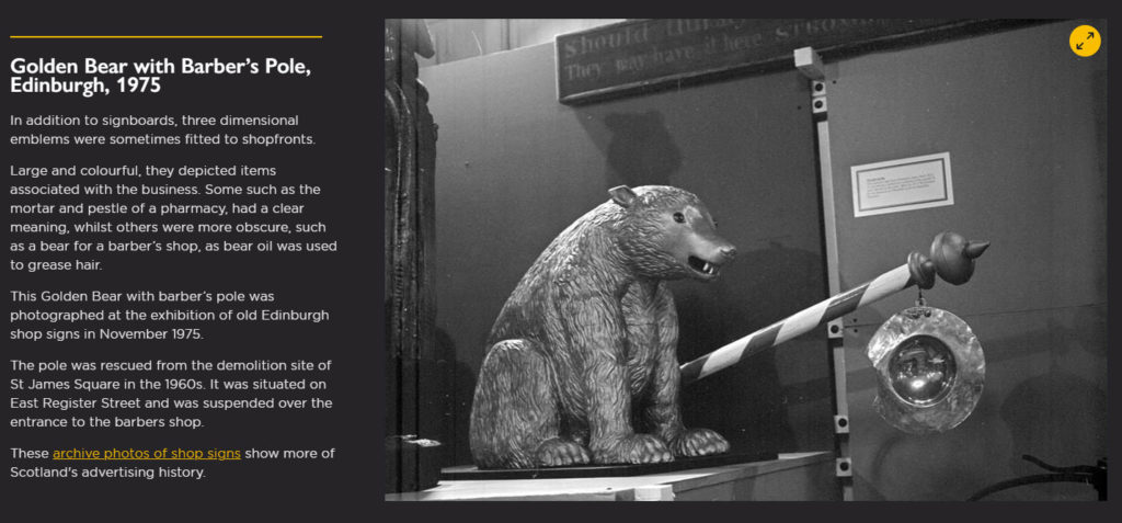 screenshot showing body of text alongside a photograph of a bear-shaped shop sign with striped pole