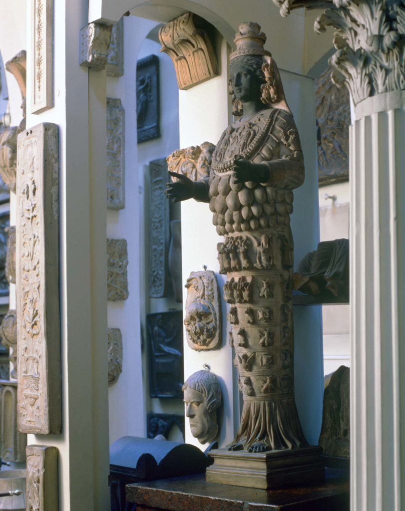 a statue of a many breasted deity