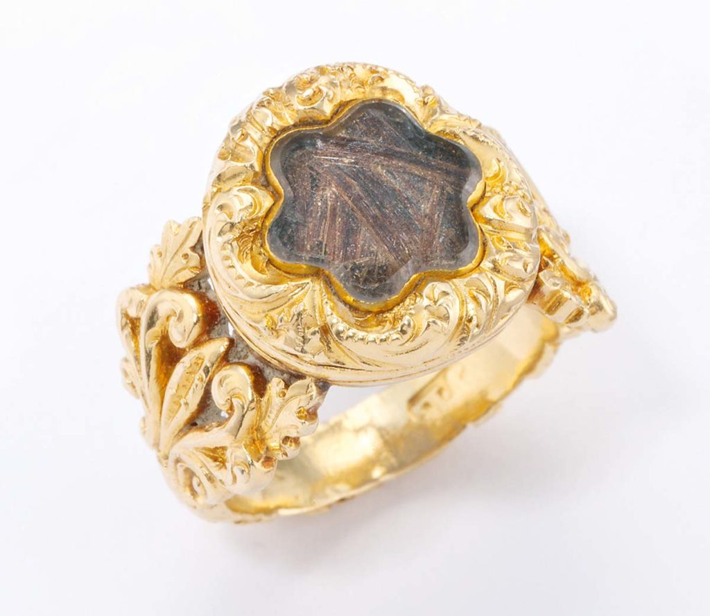 a ring with a lock of hair in it