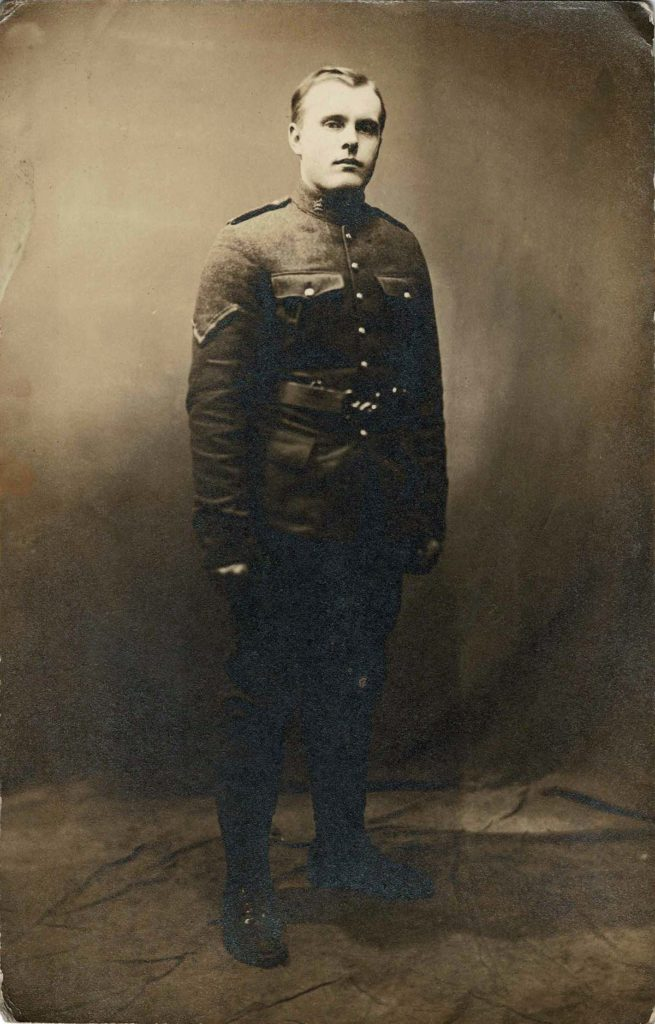 black and white full length first world war portrait of a man in soldiers uniform