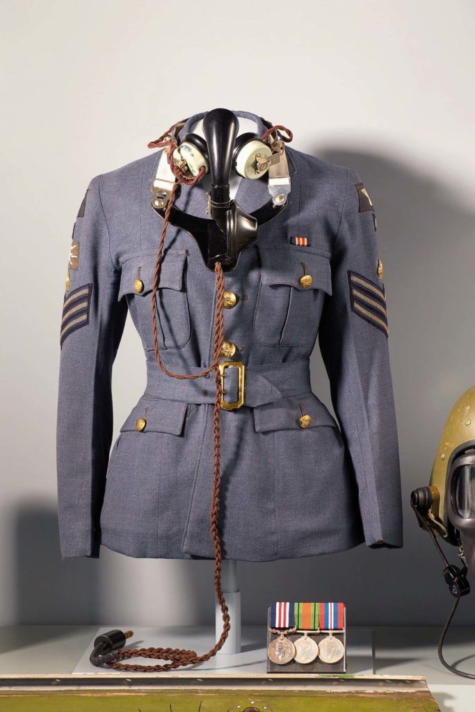 a photo of a female RAF tunic and radio headphones