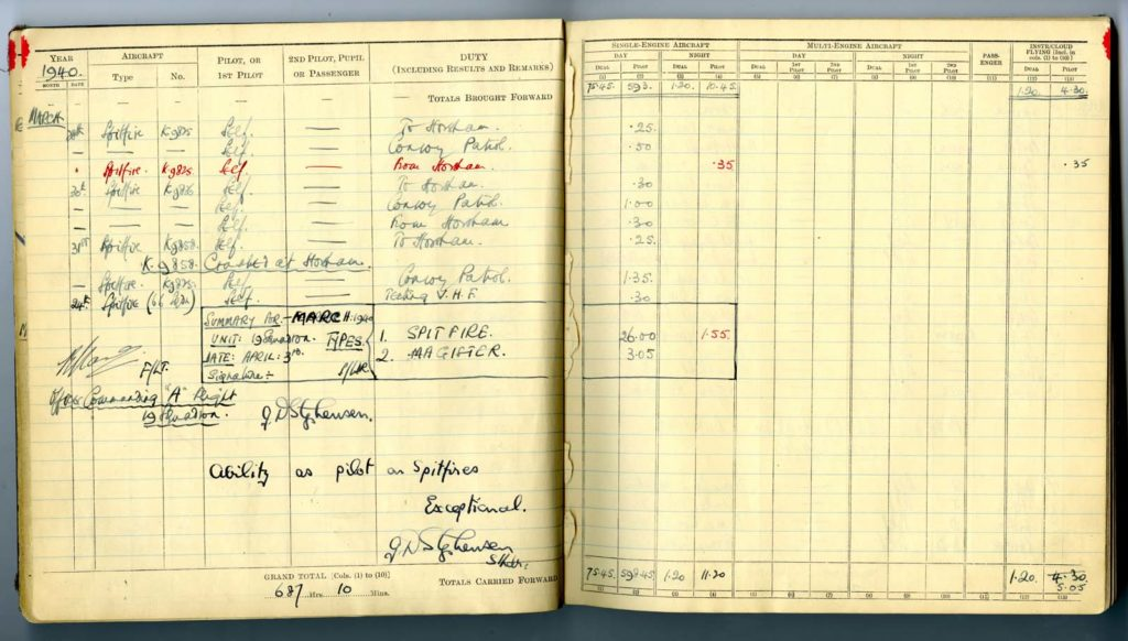 a photo of an open logbook with flight times logged