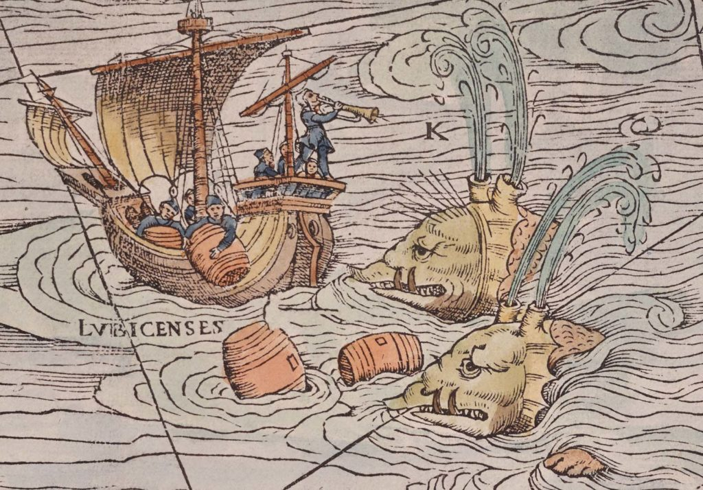 a detail of a map showing spouting sea creatures attacking a ship