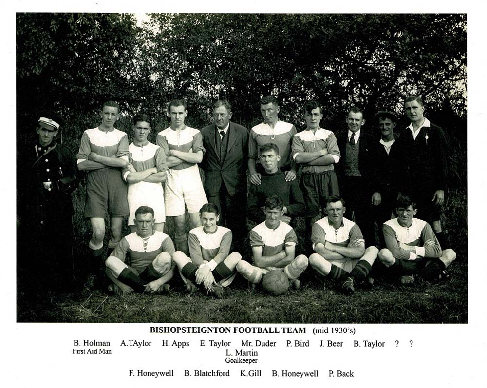 a black and white photo of a football team