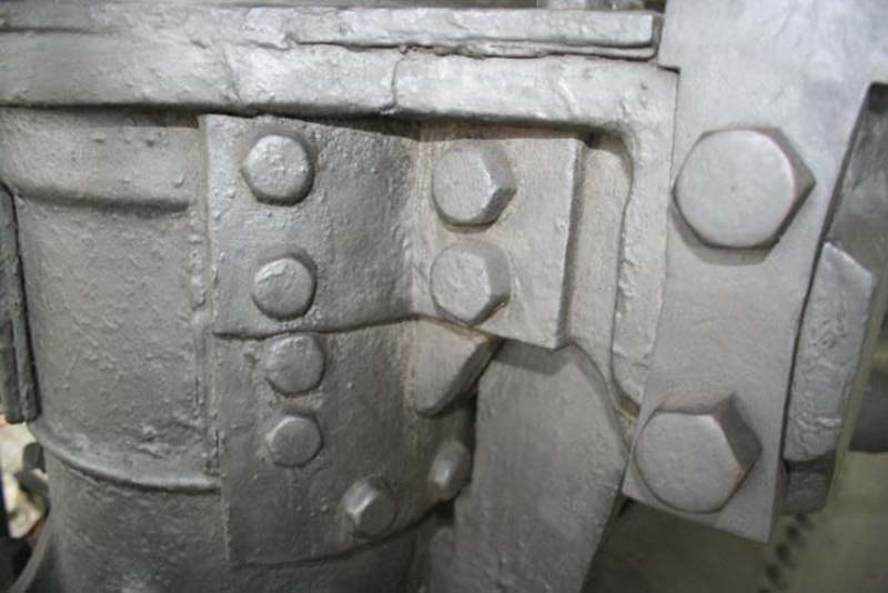 a close up of an ironwork cylinder with large bolts