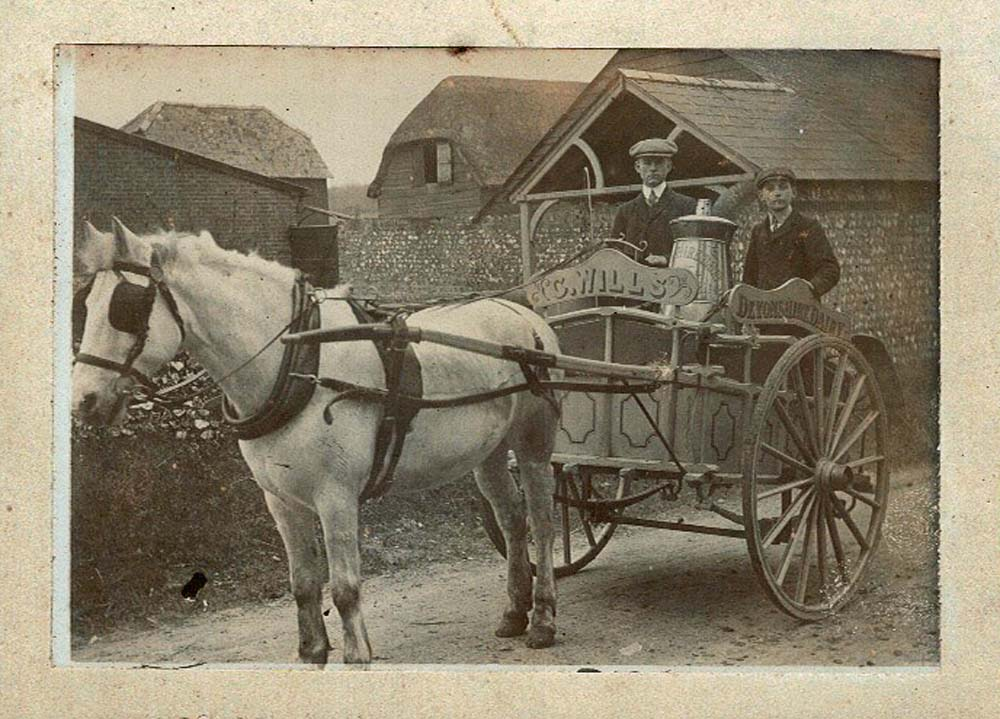 a photo of a pony and trap driven by two men