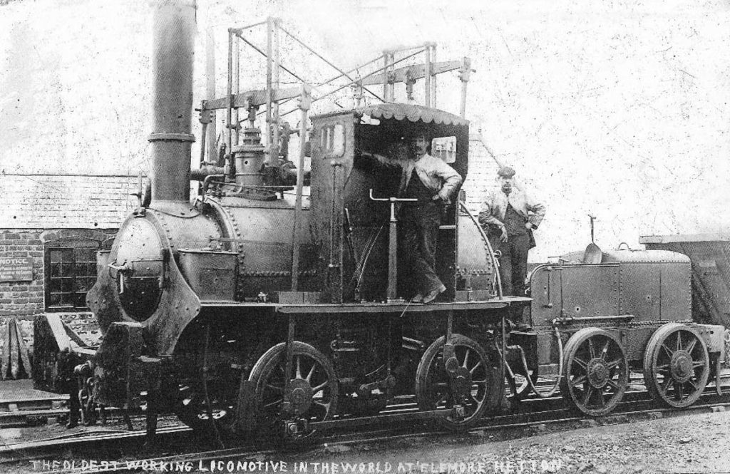 an old black and white photograph of an old steam engine with canopy over the footplate