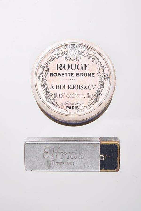 photo of a rouge tin and lipstick