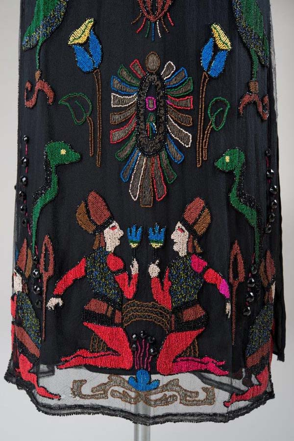 a etail from a dress featuring a pair of symmetrical igures