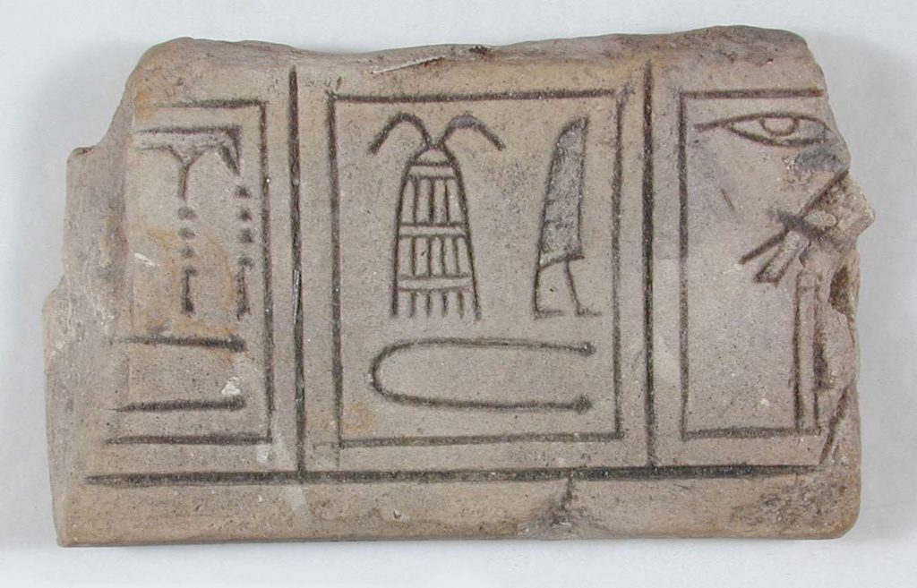 a fragment of carved stone with hieroglyphs