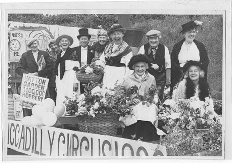 a photo of a bunch of people in fancy dress holding flowers