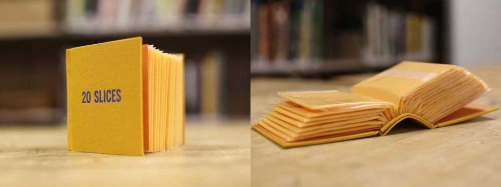 a book whose pages are plastic packaged processed cheese