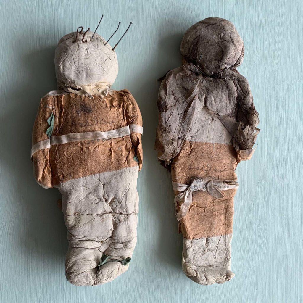 two handmade poppet dolls for practising voodoo magic