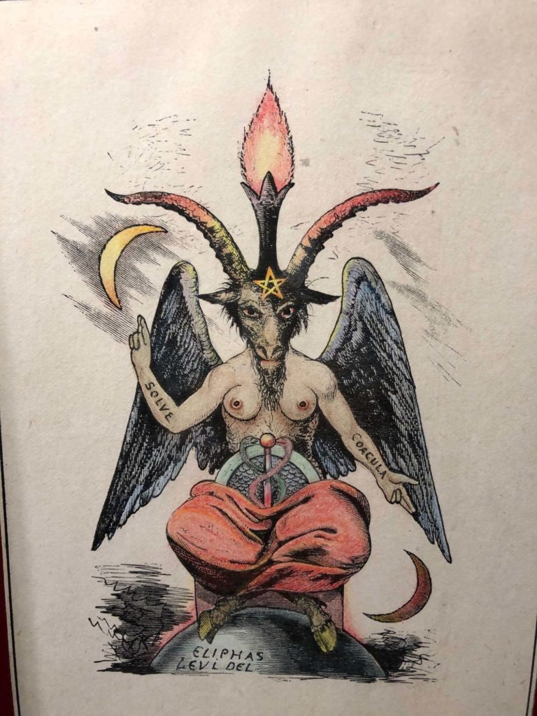 drawing of a devil figure with horns and breasts