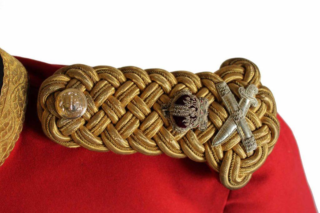 red tunic epaulette detail n gold braid