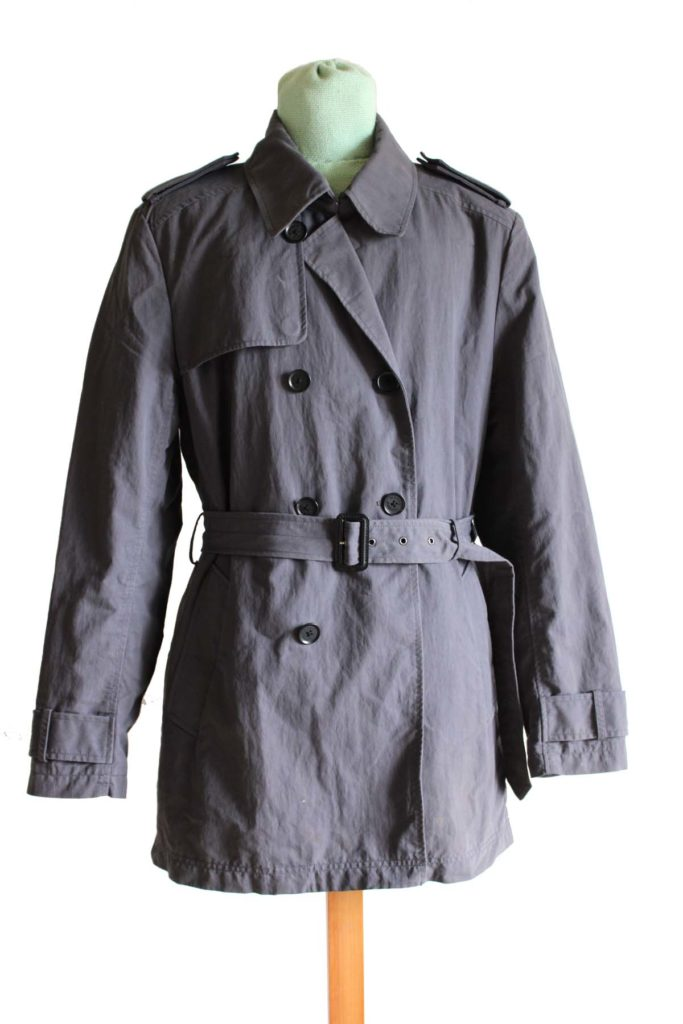a photo of a grey trench coat on a mannequin