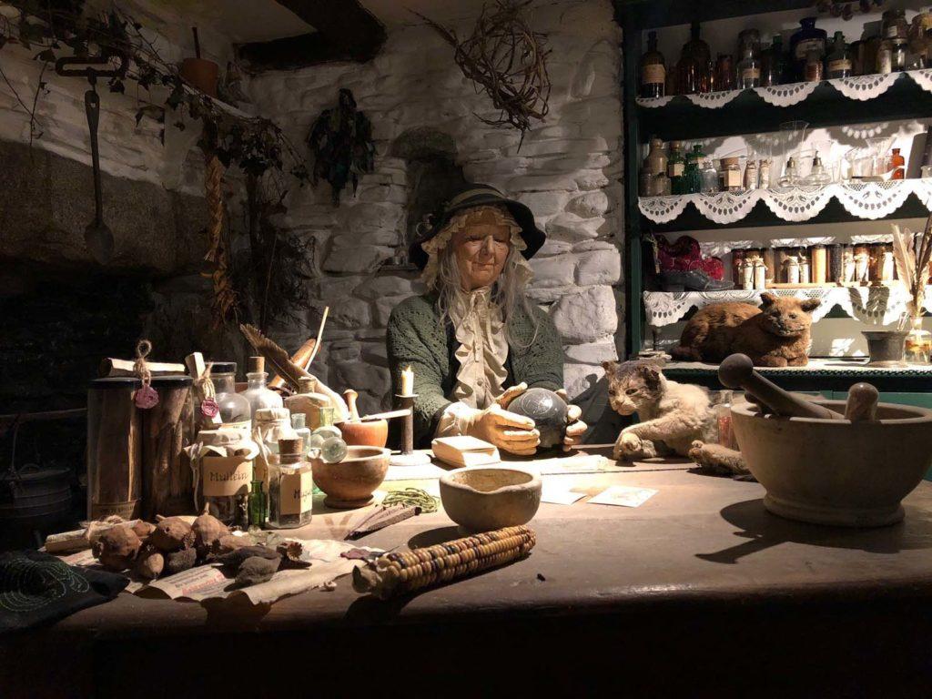 a witch mannequin in a diorama