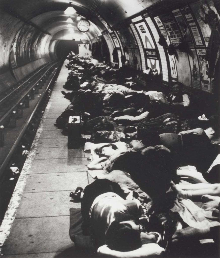 photo of a tube station filled with sleeping people