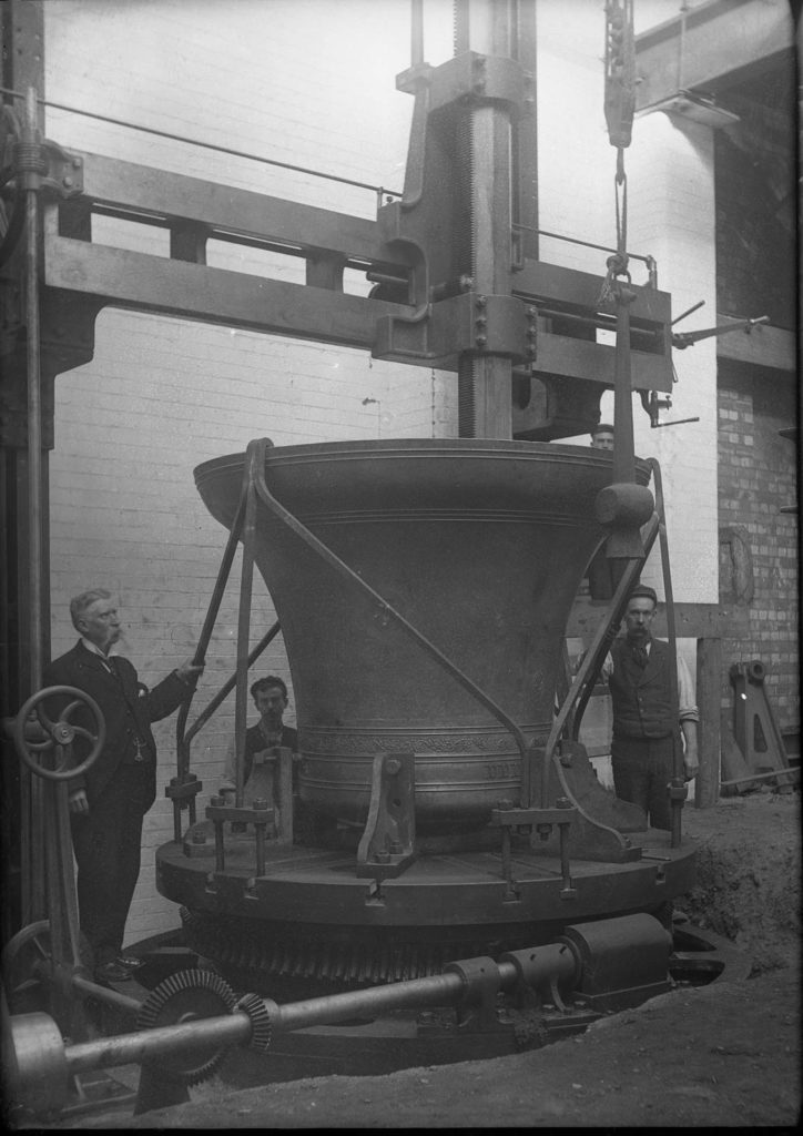 black and white photo of an upside bell in a foundry