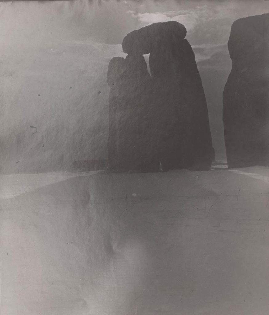 a photo of a Stonehenge shrouded in shadows