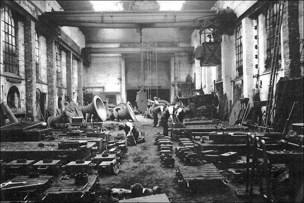 black and white photo of a large factory space