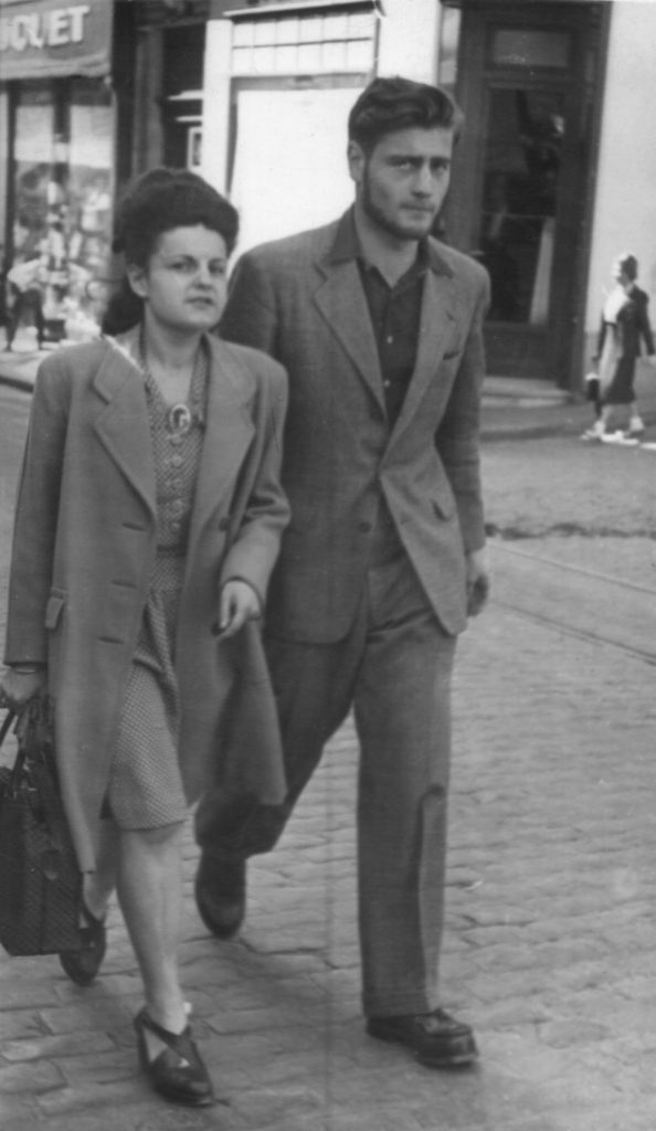 a photo of a man and woman walking in the street