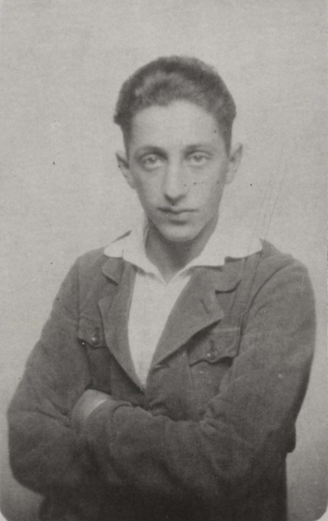 studio photo of a young man in jacket and open necked shirt