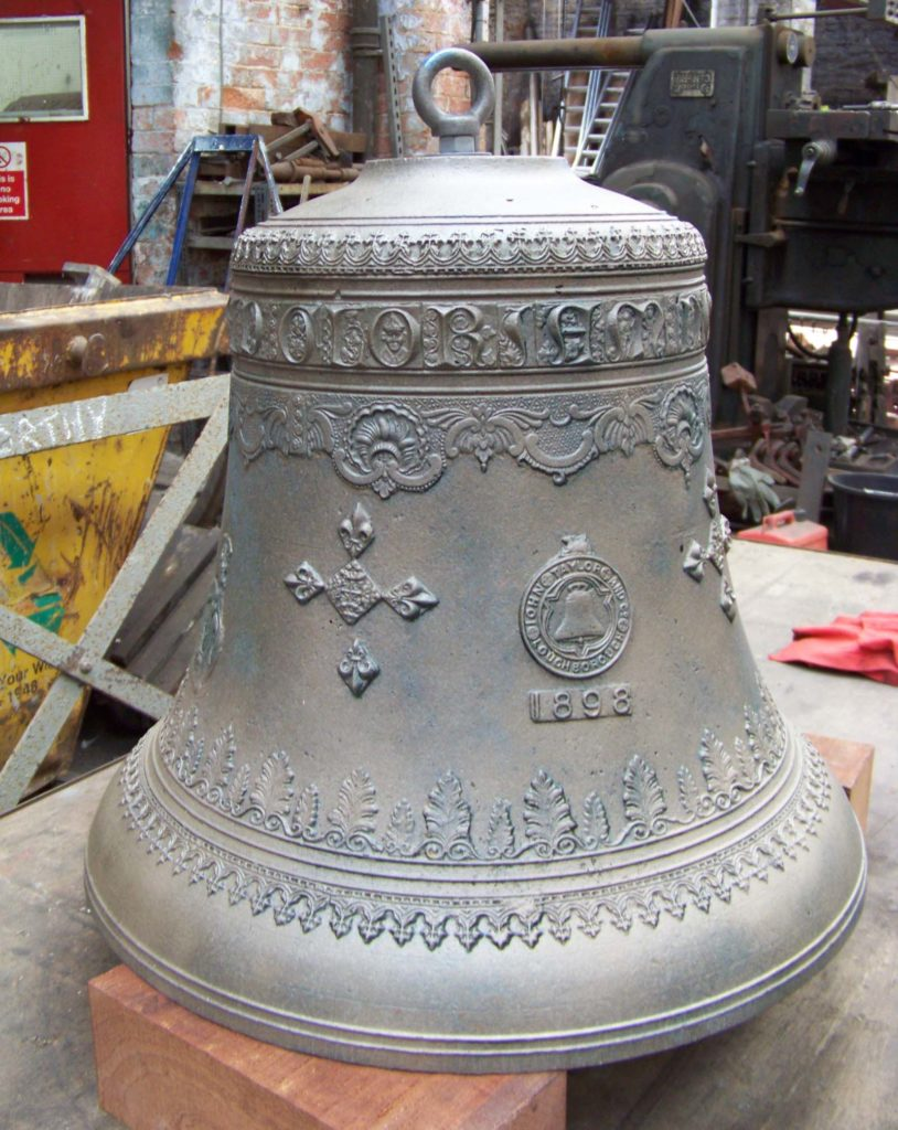 photo of a large bronze bell with cast decoration