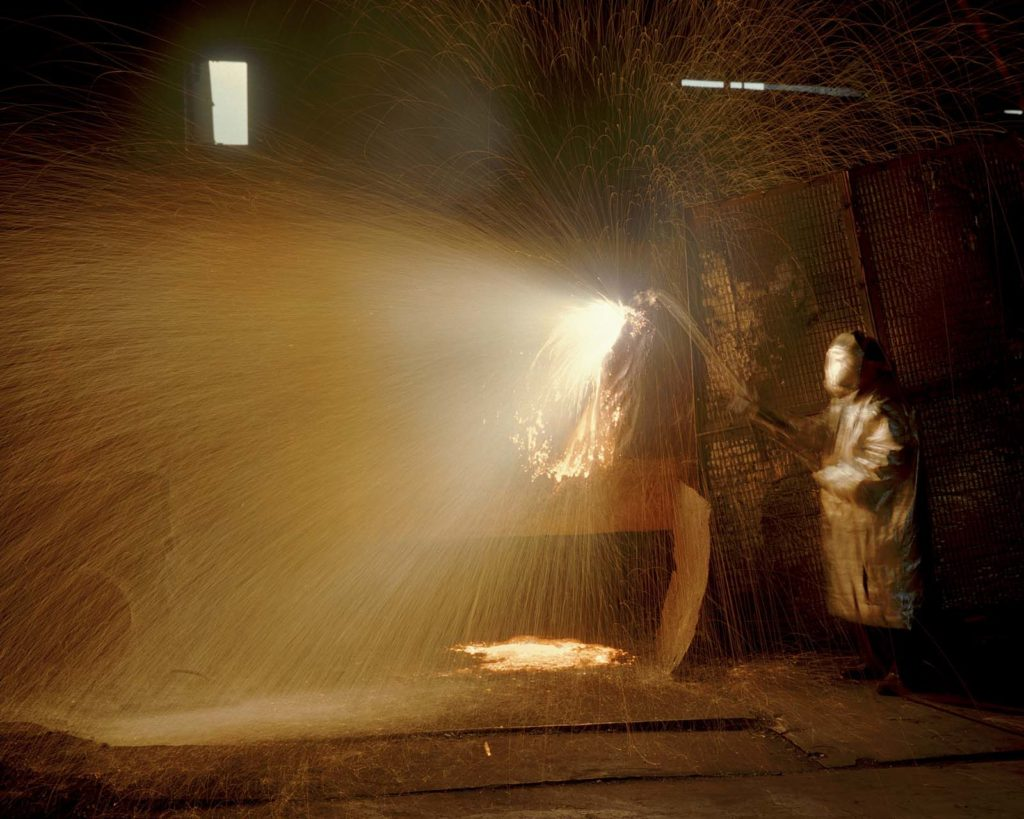 colour photo of a man in a steel furnace