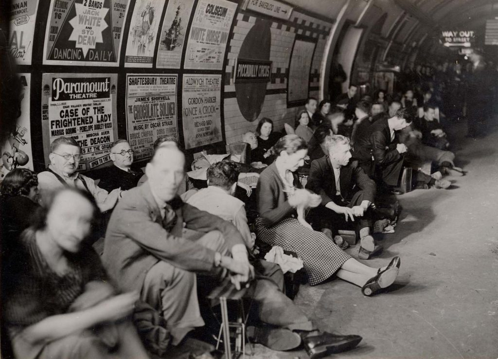 wartime photo of people on a tube platform during the Blitz