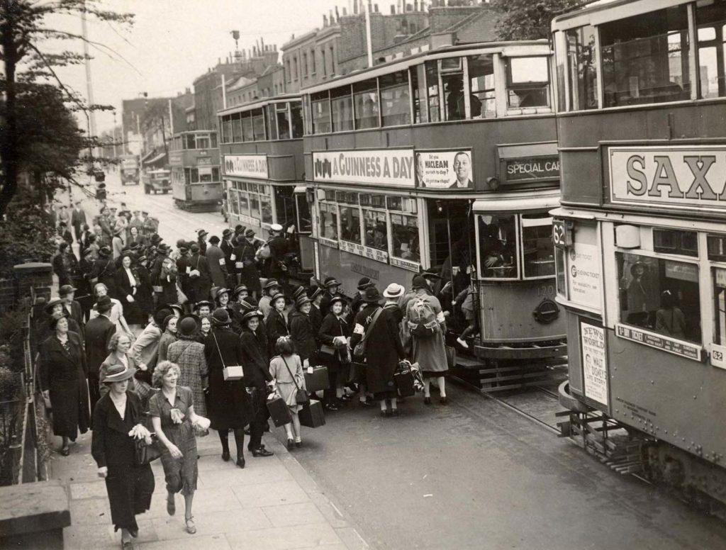 a photo of a girls in school uniform boarding trams