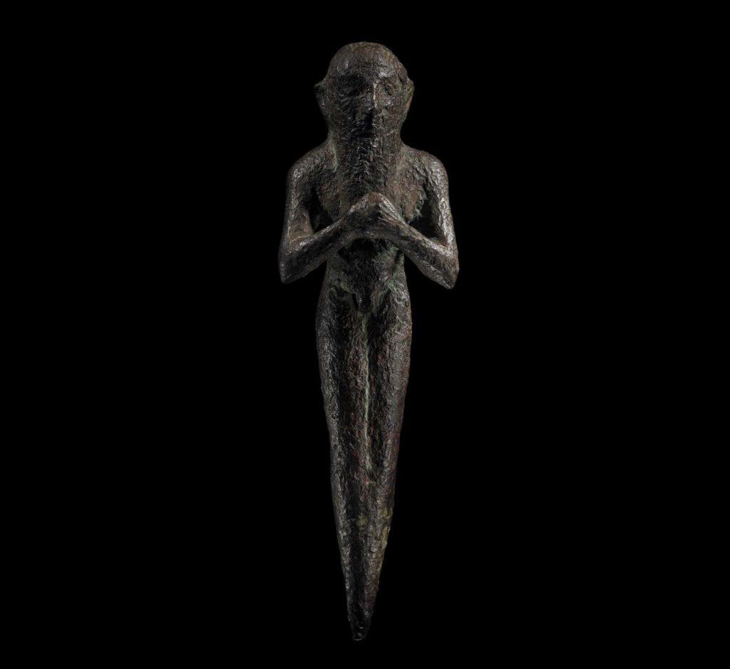a bronze figure of a man with beard