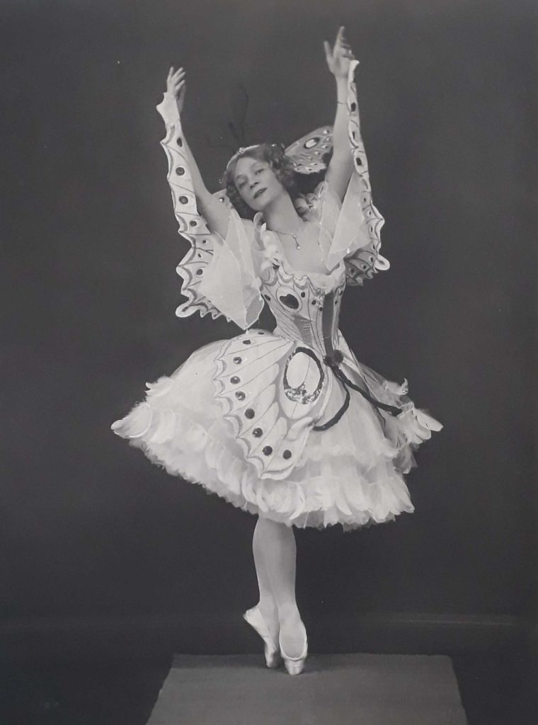 photo of a ballet dancer with arms aloft