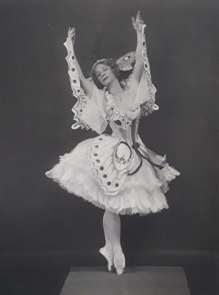 photo of a ballet dancer with arms aloft