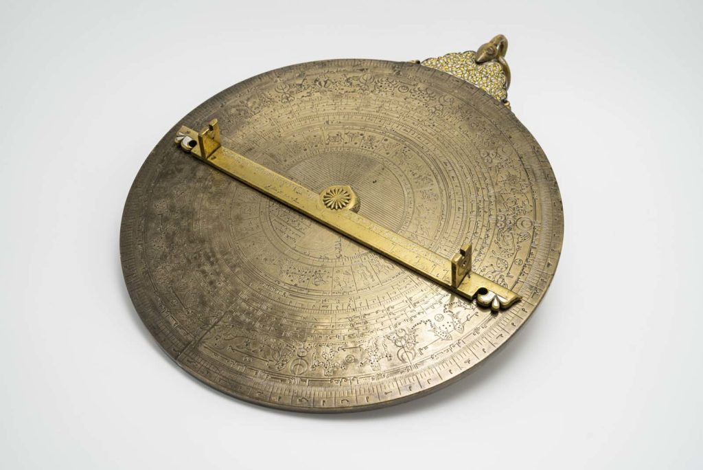 reverse view of brass astrolabe