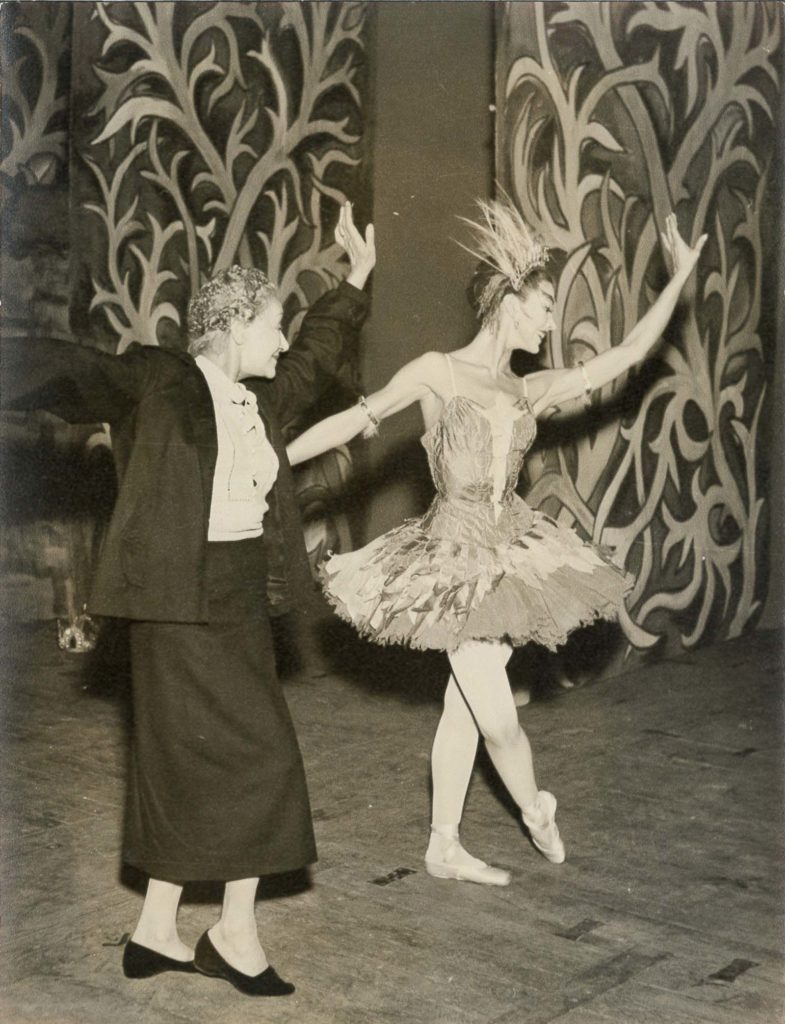 black and white photo of a ballerina being coached by a female teacher