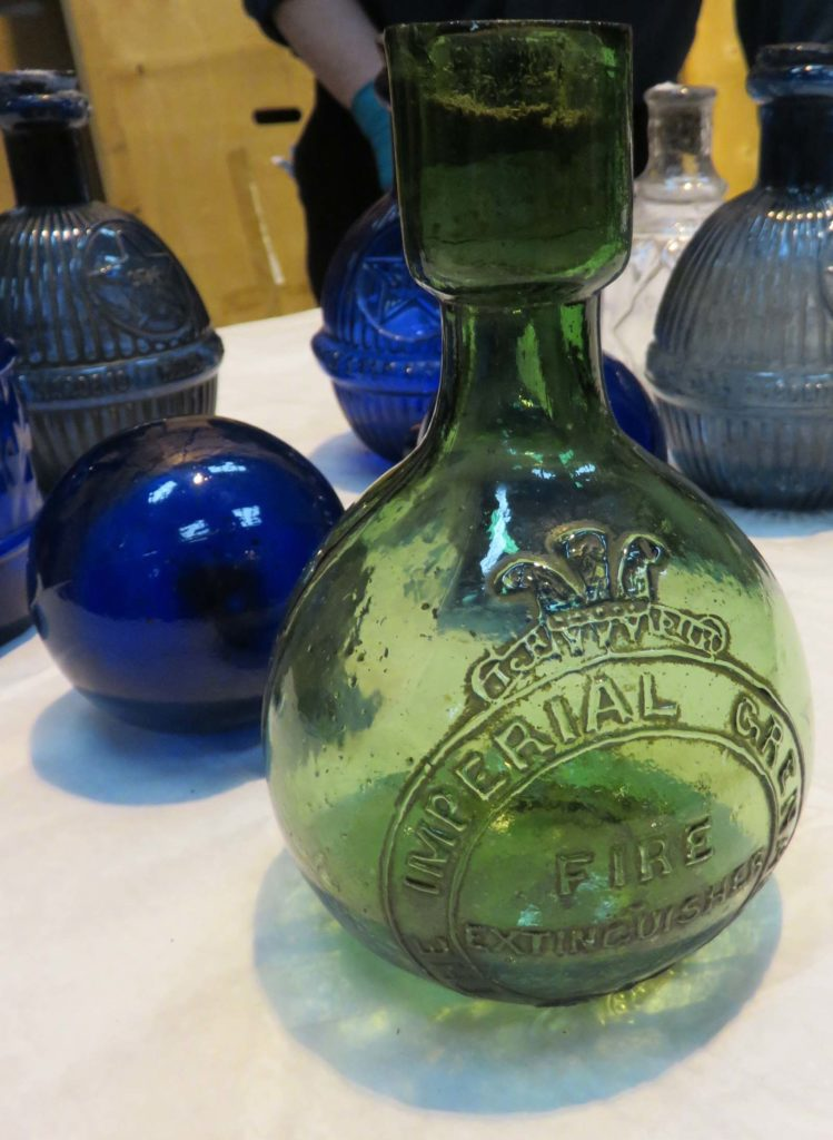 a selection of small bulbous glass bottles