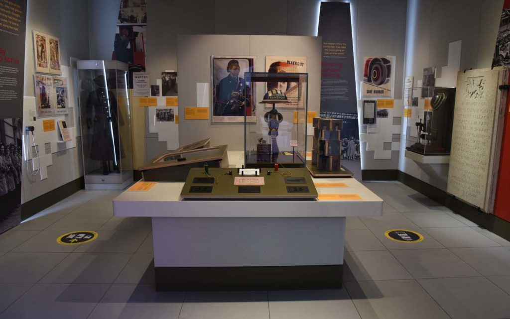 Gallery shot showing display cases posters and artefacts