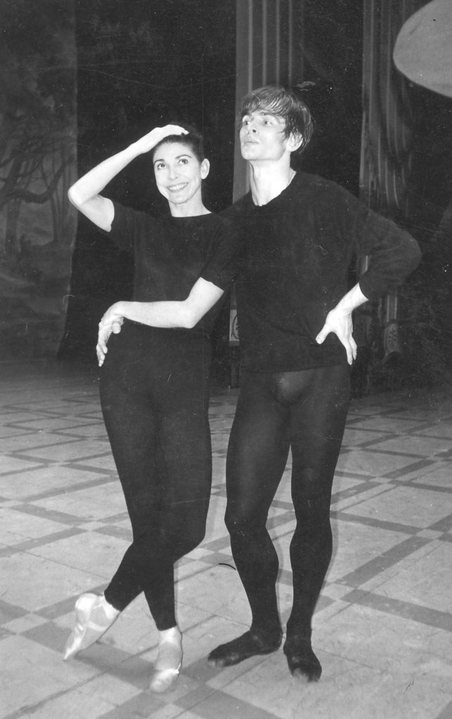 black and white photo of a male and female ballet dancer in black leotards