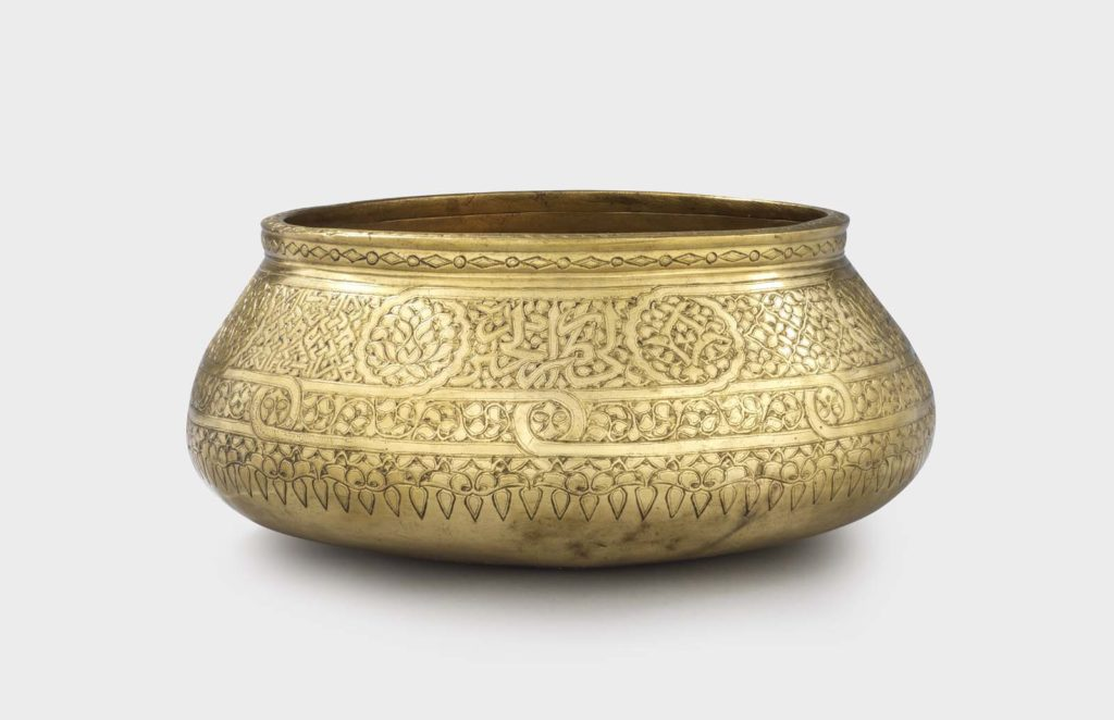 a photo of an engraved concave bowl