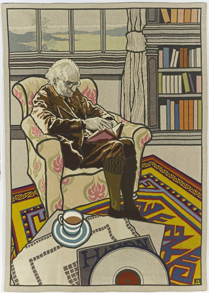 tapestry artwork depicting an elderly chap reading a book in an armchair